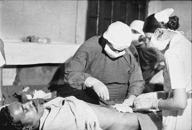 A vasectomy in progress at a family planning camp held in a government hospital in New Delhi in May 1976. Photo: Hindustan Times